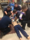 All 5 students who provided care to Lord practicing a cardiac arrest patient scenario in their lab. Photo courtesy of Gary Williams.
